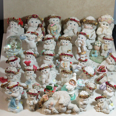 Assortment of 36 Dreamsicle Figurines, sizes vary, no boxes
