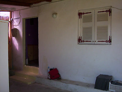 HOUSE NORTH EAST CORFU WITH LAND bargain at 25000 euro