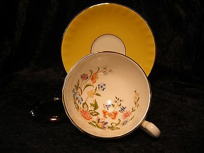 Aynsley Bone China Cup and Saucer set, yellow with interior flowers, perfect