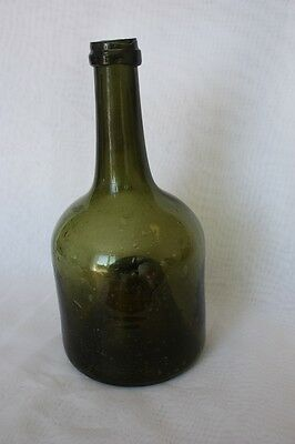"An antique ""mallet"" bottle from the end of the 18th. cent.,  onion bottle"