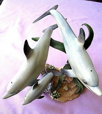 Three Dolphin Family  by Country Artists dated 2006 Hand Painted and Crafted