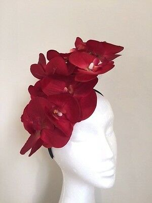 Stunning red orchid fascinator on a black headband. Gorgeous on!