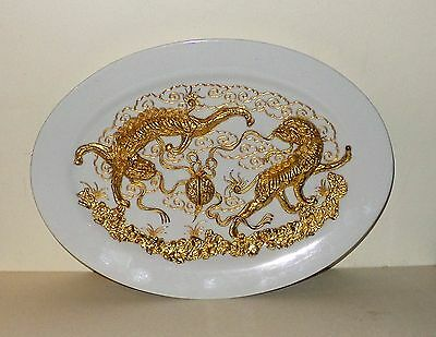 Unusual oriental  carved gilded dragon plate or dish