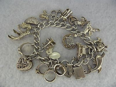 Quality Solid Silver Charm Bracelet With 20 Charms