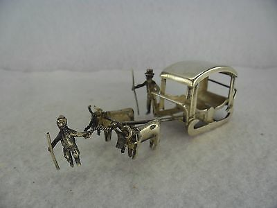 Solid Silver Figurine of Man & Two Bulls Pulling a Sleigh