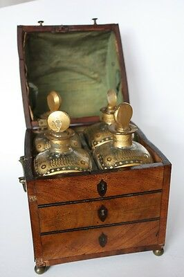 An antique tantalus/liquor cabinet in the form of a roll top desk