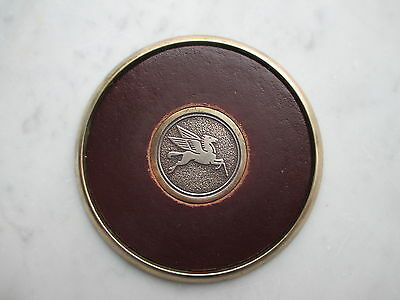 Socony / mobilgas  PEGUSUS on brass disc  with leather insert.