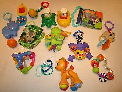 Lot of baby developmental toys.  Stroller hanger, soft books,  clean and bright!