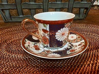 Ornate deep jewel toned oriental patterned tea cup and saucer