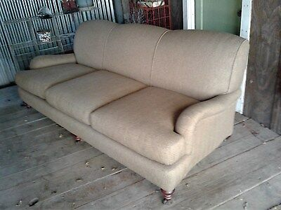 French Country Style Sofa Couch, dark wheat weave, on rollers.