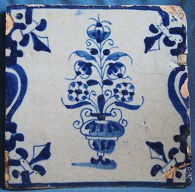 Blue and white antique Delft tile with flowers in a  vase