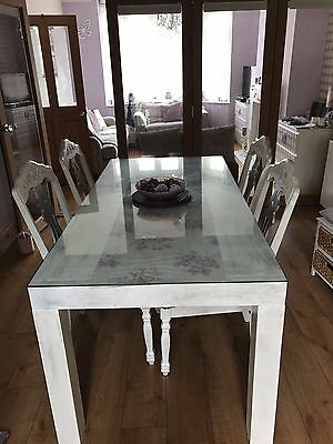 Recangular shabby chic dining table with  glass top and 4 upholstered chairs