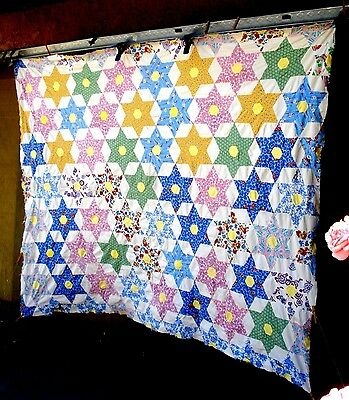 Vintage 1930's six point star quilt top with feed sack fabric