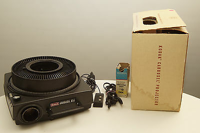 Kodak Carousel 650 Slide Projector with tray, remote, lens, and extra bulb
