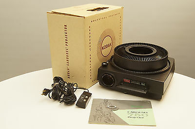 Kodak Carousel 750 Slide Projector with tray, remote, and lens