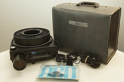 Kodak Carousel 860 Auto-Focus Slide Projector with tray, remote, and zoom lens