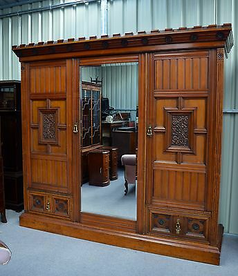 very large antique walnut Arts and crafts triple wardrobe compactum