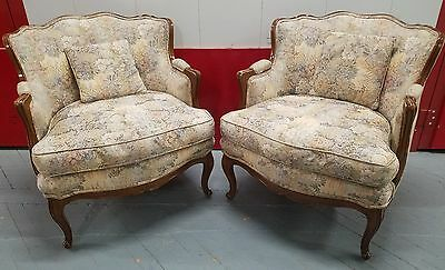 Pair of French Louis XV Style Carved Fruitwood upholstered Antique Arm Chairs