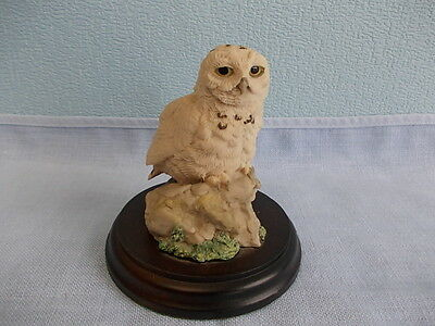 Vintage little owl ornament on wood stand - snow owl on rock