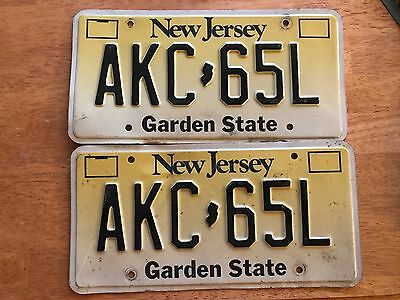 Pair Of Yellow and White New Jersey License Plate AKC 65L Vintage