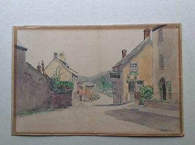 WATERCOLOUR ON BOARD of a country village high street. Circa 1910 signed.
