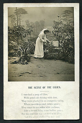 C1910 Bamforth Song Card: The Scent of the Lilies: Lady Picking Flowers