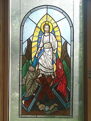 Religious stained glass panel/ Christ resurrecting the dead.