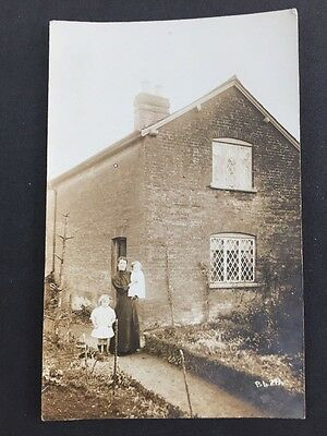 Vintage Postcard: Real Photo: Anonymous People Outside House: #A51