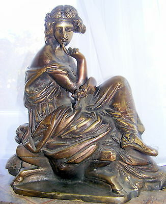 Vintage bronze sculpture statue on stepped marble base..