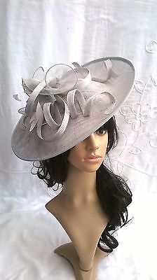 Silver Feather Fascinator..Hatinator shaped disc Wedding.races.new