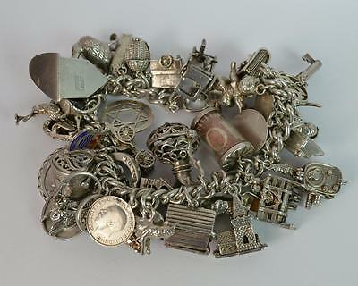 Huge and Heavy Solid Silver Ladies Charm Bracelet with Lot of Charms