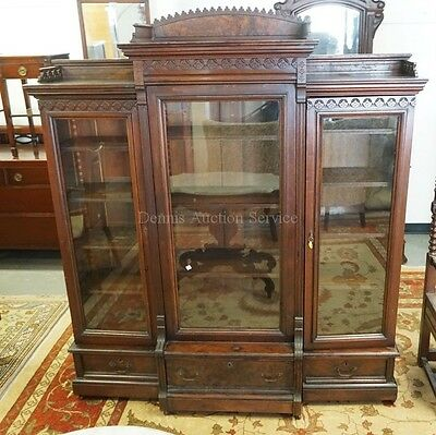 VICTORIAN WALNUT BOOKCASE WITH GLASS DOORS, CARVED ACCENTS, AND BURL... Lot 1273