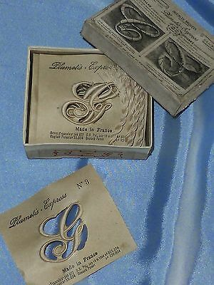 10 Antique French Embroidered monograms for linens in original box. Letter G