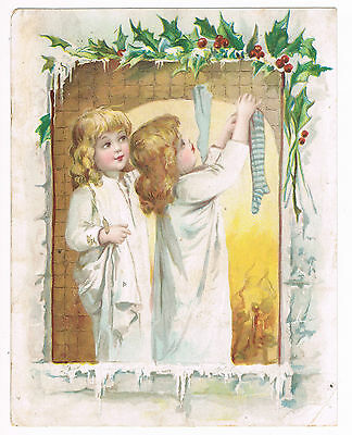 LION COFFEE Christmas Greetings Hanging Stockings Brundage Victorian Trade Card