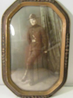 Antique ornate Oval Picture Frame With Hand Tinted Portrait Of Soldier