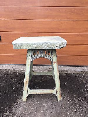 Reclaimed upcycled antique stone garden table with industrial cast iron base