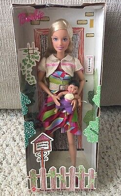 #2012 NRFB Mattel White Swan Hotel Going Home Adoption Barbie #6 Doll