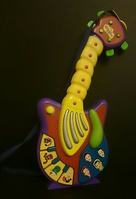 The Wiggles musical guitar - plays music Includes shoulder strap GWO