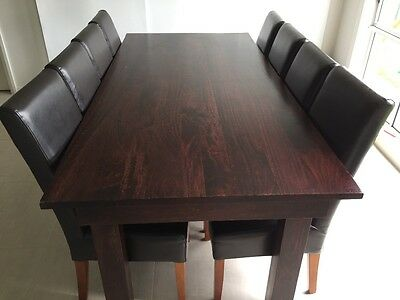 Solid timber, hard wood table with 8 dark brown leather chairs