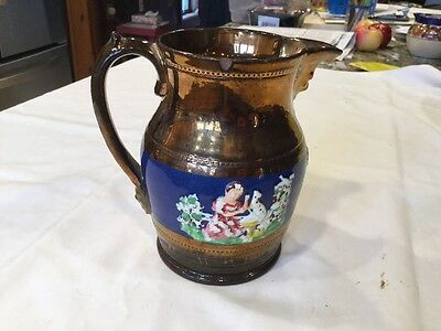 """Antique 6"""" Copper Luster Ware Pitcher With Dark Blue Band & Raised Figures"""