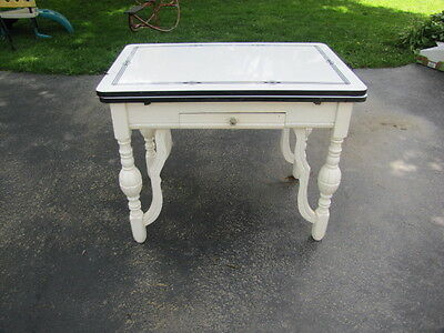 Porcelain Top Wooden Leg Kitchen Farm Table With Black Stencil And Is Expandable