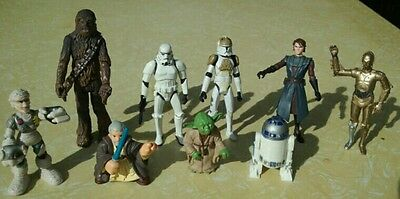 Group lot of Star Wars figurines.