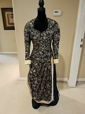 Victorian bustle dress in black and gold
