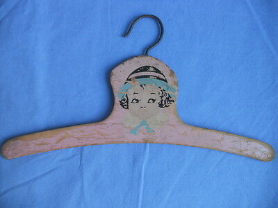 True Vintage Wooden Girl's Clothes Hanger Pink Wood (Girl Wearing Hat) 1920's