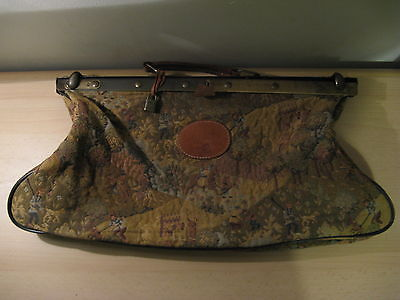 Old French tapestry medical bag with brass buckle and leather accenten..Years 20