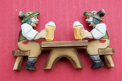 Hand carved seated two German beer drinkers with moving arms,  ( Cheers ).