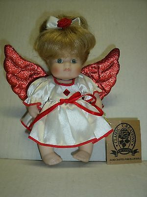 Classic Creations Porcelain July Birthstone Angel doll with Red Wings