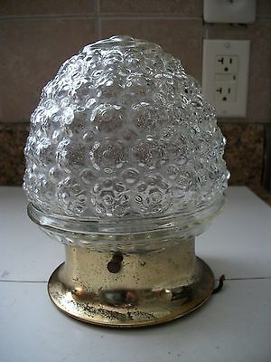 "Single Light Ceiling Fixture Brass base pitted with acorn globe 7"" tall 6"" wide"
