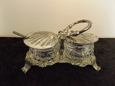 Glass Jam dishes in metal surround