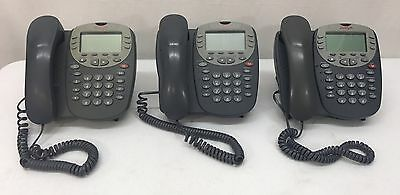 Lot of (3) Avaya 5610SW IP Digital Office Phones with Handsets & Stands